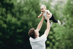 Happy joyful child playing with father outdoors. Daddy and daugh stock photography