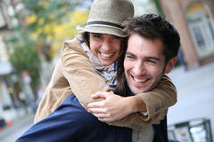 Happy joyful couple in the city streets Royalty Free Stock Photos