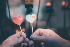Happy joyful couple give heart candle to each other in front of candle light, Love concept royalty free stock photography
