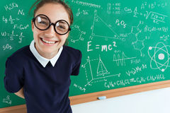Happy joyful girl near blackboard. royalty free stock photography