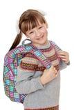 Happy joyful girl schoolgirl with satchel behind Stock Images