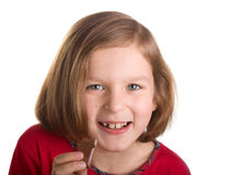 Happy joyful little girl eating chocolate Royalty Free Stock Images