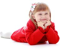 Happy joyful little girl lying on the floor Royalty Free Stock Images