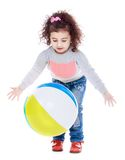 Happy joyful little girl playing with a ball Stock Photography