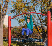 Happy joyful  little girl playing on kids playground in park Royalty Free Stock Images