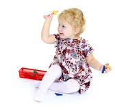 Happy joyful little girl sitting on the floor Stock Photography
