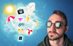 Happy joyful man with sunglasses looking at summer icons Royalty Free Stock Photos