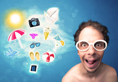 Happy joyful man with sunglasses looking at summer icons Royalty Free Stock Photography