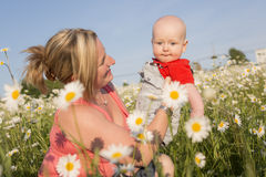 Happy joyful mother with baby son Royalty Free Stock Photography