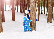 Happy and joyful mother and child on walk, play in the winter forest. Pine forest of Chelyabinsk region, Ural, Russia Stock Images
