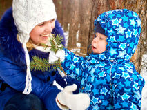 Happy and joyful mother and child on walk, play in the winter forest. Pine forest of Chelyabinsk region, Ural, Russia Royalty Free Stock Image
