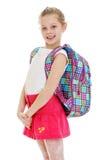 Happy joyful schoolgirl in red skirt and school Royalty Free Stock Photography