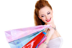Happy joyful woman with purchases in hands Royalty Free Stock Photography