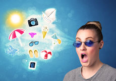 Happy joyful woman with sunglasses looking at summer icons Stock Image