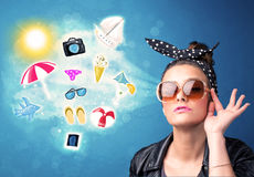 Happy joyful woman with sunglasses looking at summer icons Stock Images