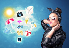 Happy joyful woman with sunglasses looking at summer icons Royalty Free Stock Image