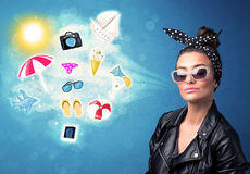 Happy joyful woman with sunglasses looking at summer icons. And symbols concept Stock Image