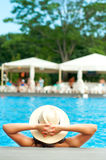 Happy, joyful woman at tropical pool relaxing Royalty Free Stock Photography