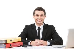 Happy and joyful worker sitting at desk. Stock Photo