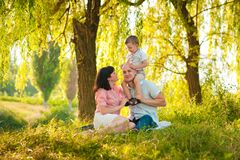 Happy joyful young family with child Stock Photos