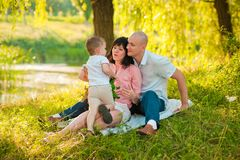 Happy joyful young family with child outdoors Stock Photography