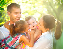 Happy joyful young family having fun outdoors Stock Photos