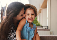 Happy joying kid girl embracing with beautiful mother on summer Stock Images