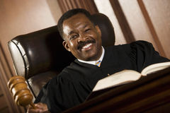 Happy Judge Holding Gavel Stock Photo