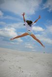 Happy jump. Teenager having fun and enjoys summer Stock Photography
