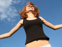 Happy jump. Beautiful woman jumping happy with blue sky Stock Photography