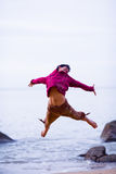Happy jump 2. A young man jumping at the beach high and wide Royalty Free Stock Photos