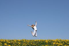 Happy jump!. Beautiful smiling young woman in a happy jump Royalty Free Stock Images