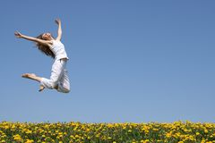 Happy jump. Beautiful smiling young woman in a happy jump stock photos