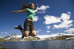 Happy jump. Happy girl jumping in norway Stock Images