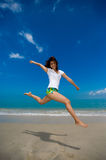 Happy jump at the beach. Young beautiful girl jumping happily at the beach Stock Photo