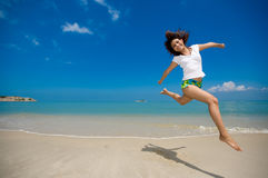 Happy jump at the beach Royalty Free Stock Photo