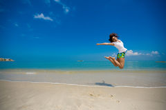 Happy jump at the beach royalty free stock photography
