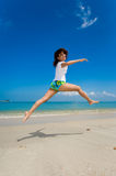 Happy jump at the beach. Young beautiful girl jumping happily at the beach Royalty Free Stock Photo