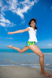Happy jump at the beach. Young beautiful girl jumping happily at the beach Stock Photography