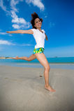 Happy jump at the beach. Young beautiful girl jumping happily at the beach Stock Image