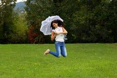 Happy jump with lace umbrella Stock Photos