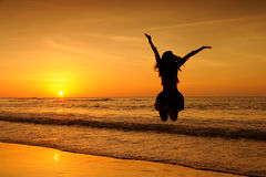 Happy jump woman in Sea Sunset at krabi Thailand Royalty Free Stock Photography