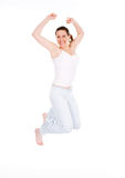 Happy Jumping. Happy cute woman jumping on white background Stock Photography