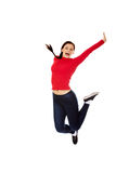 Happy jumping beautiful young woman Royalty Free Stock Image
