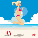 Happy Jumping Blonde Bikini Girl Stock Image