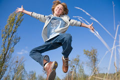 Happy jumping boy Stock Photography