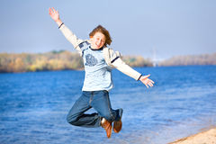 Happy jumping boy on beach Royalty Free Stock Photos