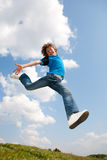 Happy jumping boy. Focus on eyes Royalty Free Stock Image