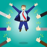 Happy Jumping Businessman Getting Thumbs Up From Others Royalty Free Stock Images