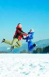 Happy jumping couple Royalty Free Stock Images